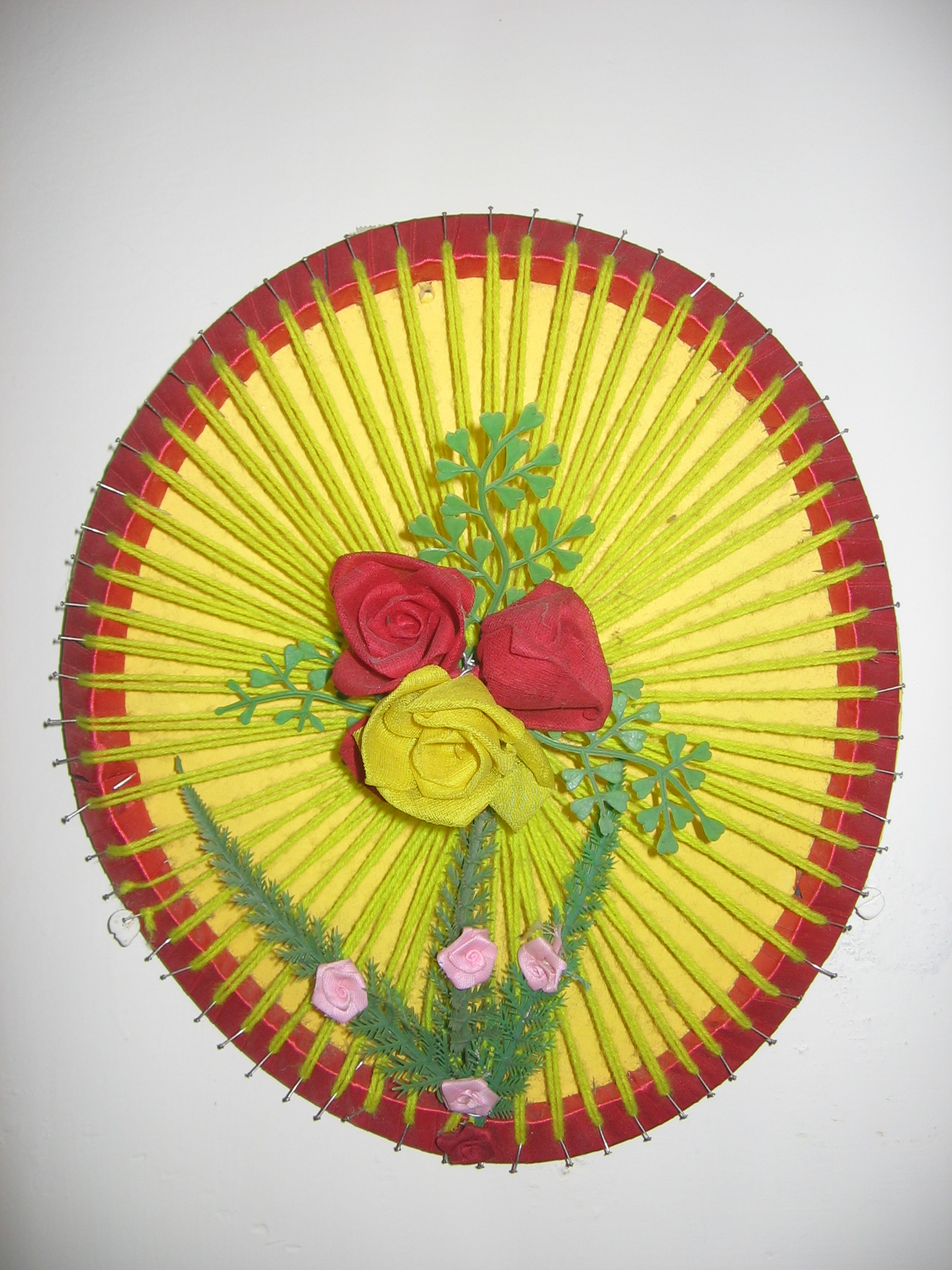 Floral wall hanging with cooker gasket -